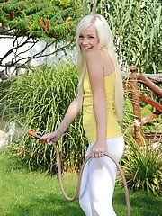 Exotic blonde teen flaunts her body outdoors