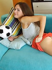 Stunning Nubile Rachelle pulls up her sexy mini skirt and starts posing on the couch