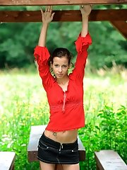Nubile loves spreading her long legs when wearing a mini skirt outdoors