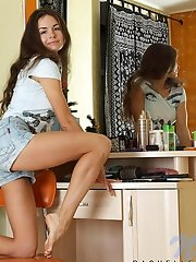 Long haired babe Rachelle takes off her denim shorts to show us the panty she is on