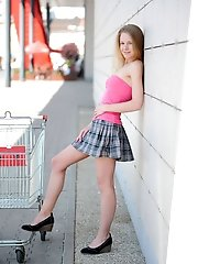 Skinny blonde teen lifts her skirt in a public grocery store parking lot