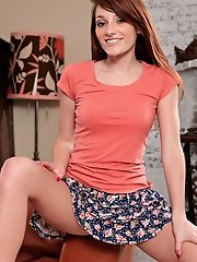 Cute girl Tiffany Haze slides off her mini skirt exposing her pink panties